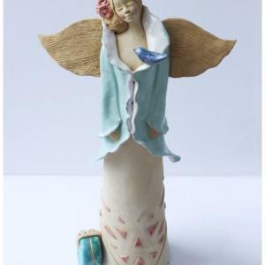Anioł podróżny z walizką