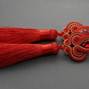 czerwono-złote kolczyki lub klipsy sutasz