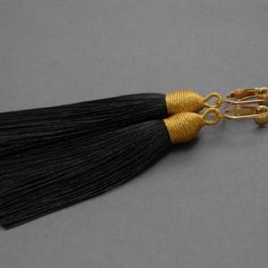 kolczyki lub klipsy z chwostami (czarne)
