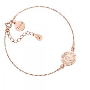 Bransoletka z różowego złota z medalionem