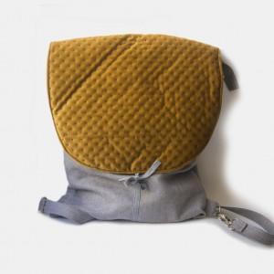 Szary plecak z miodową klapą