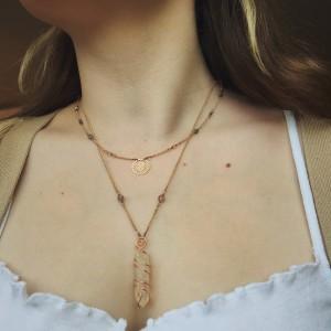 Dwuczęściowy naszyjnik z kryształem górskim i symbolem słońca