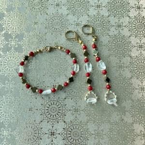 Komplet biżuterii z koralem i kryształem górskim.